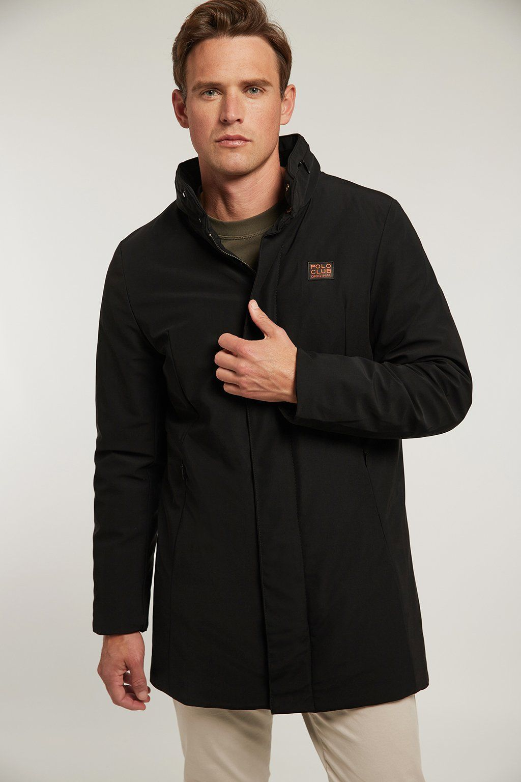 Black technical coat with high collar
