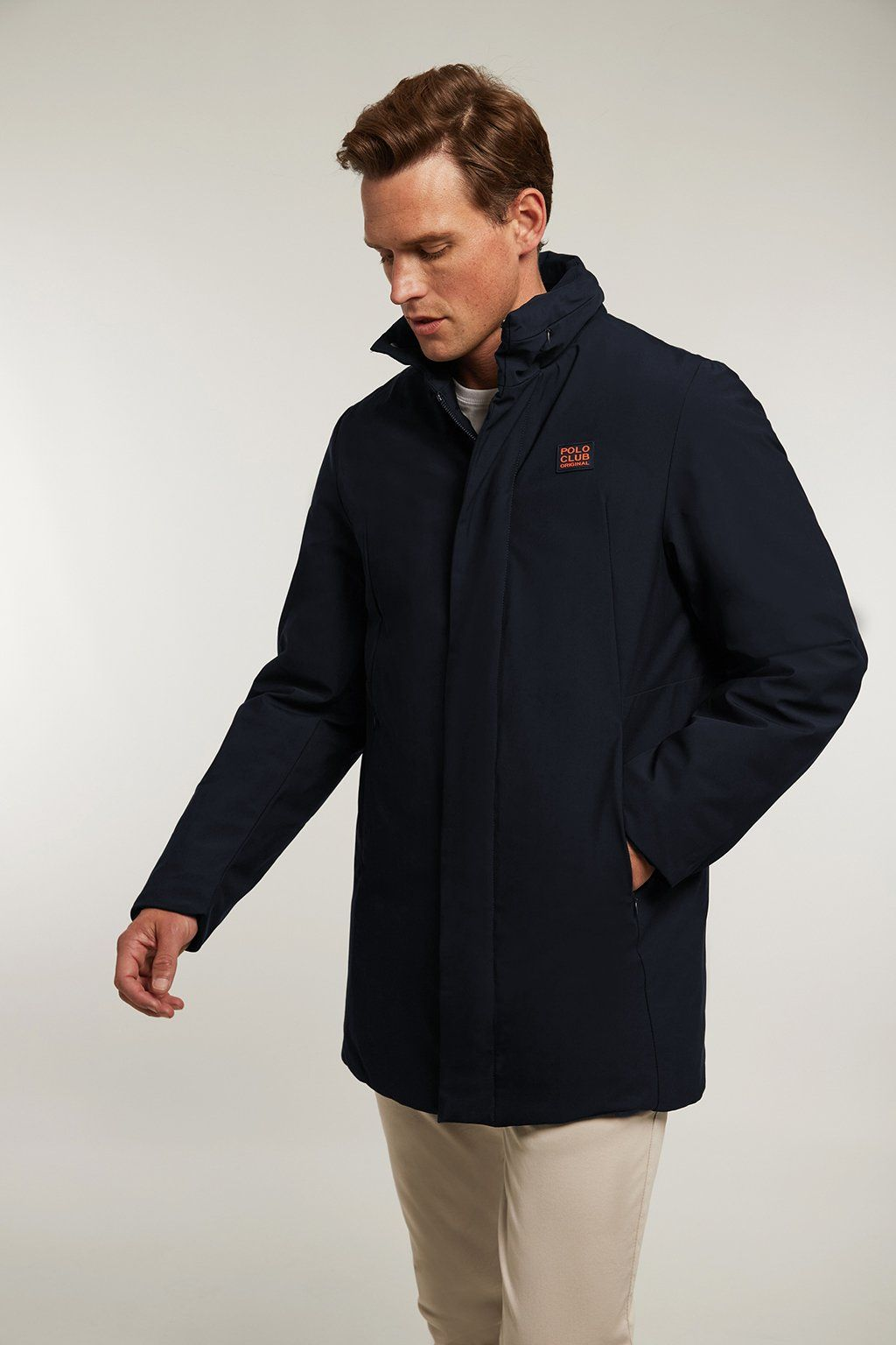 Navy blue technical coat with high collar