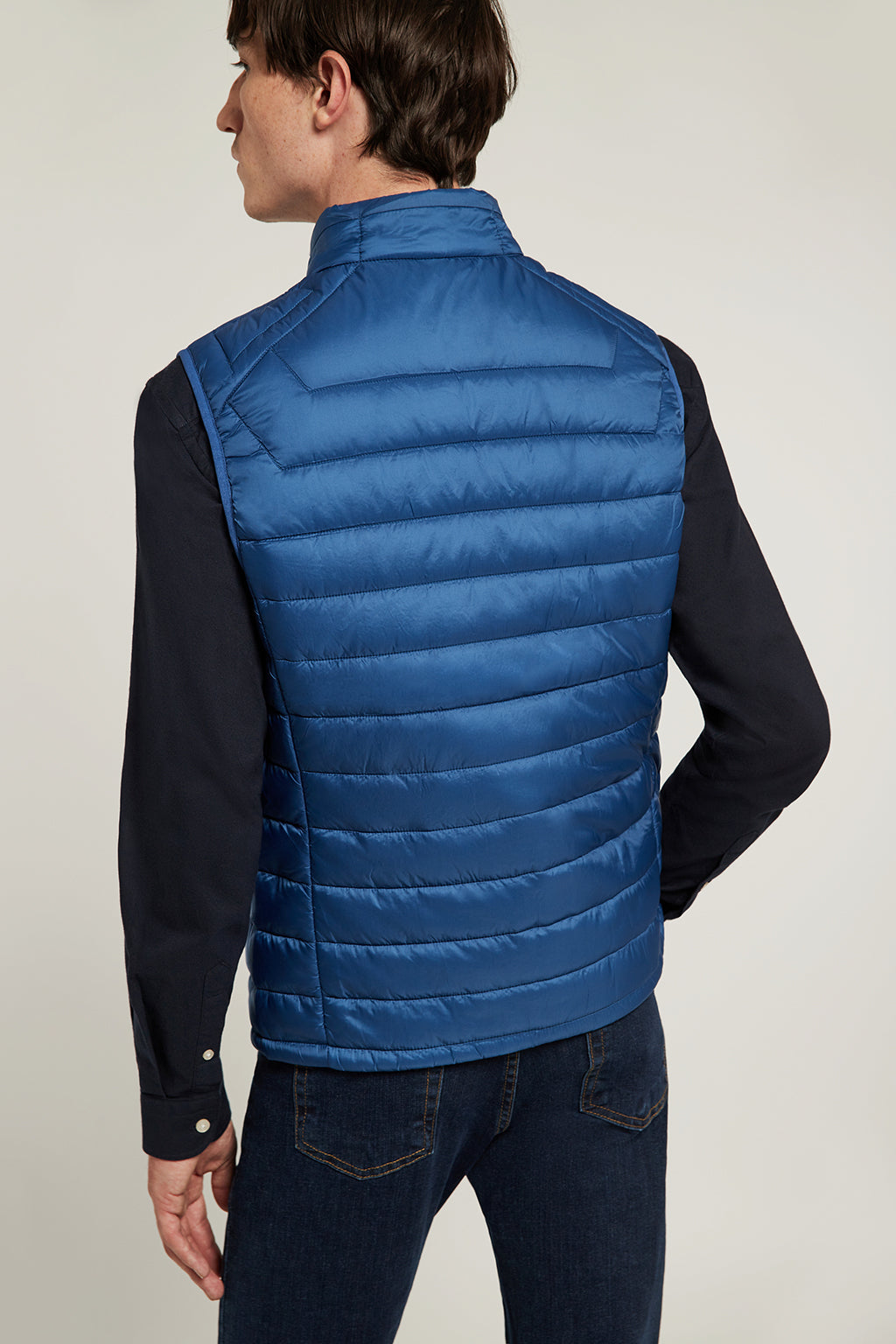 Royal blue quilted vest with high collar