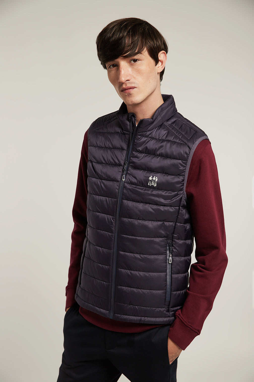 Blue quilted vest with high collar