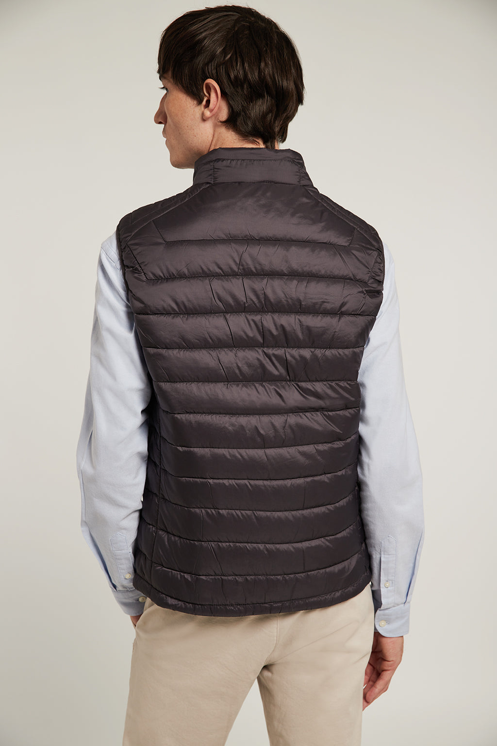 Grey quilted vest with high collar