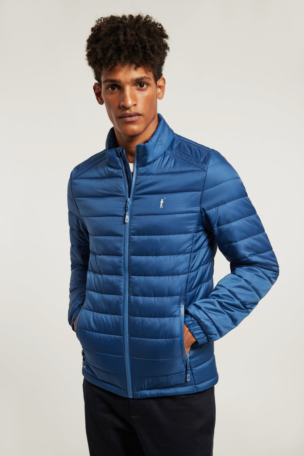 Royal blue quilted jacket with heat-sealed zip closure