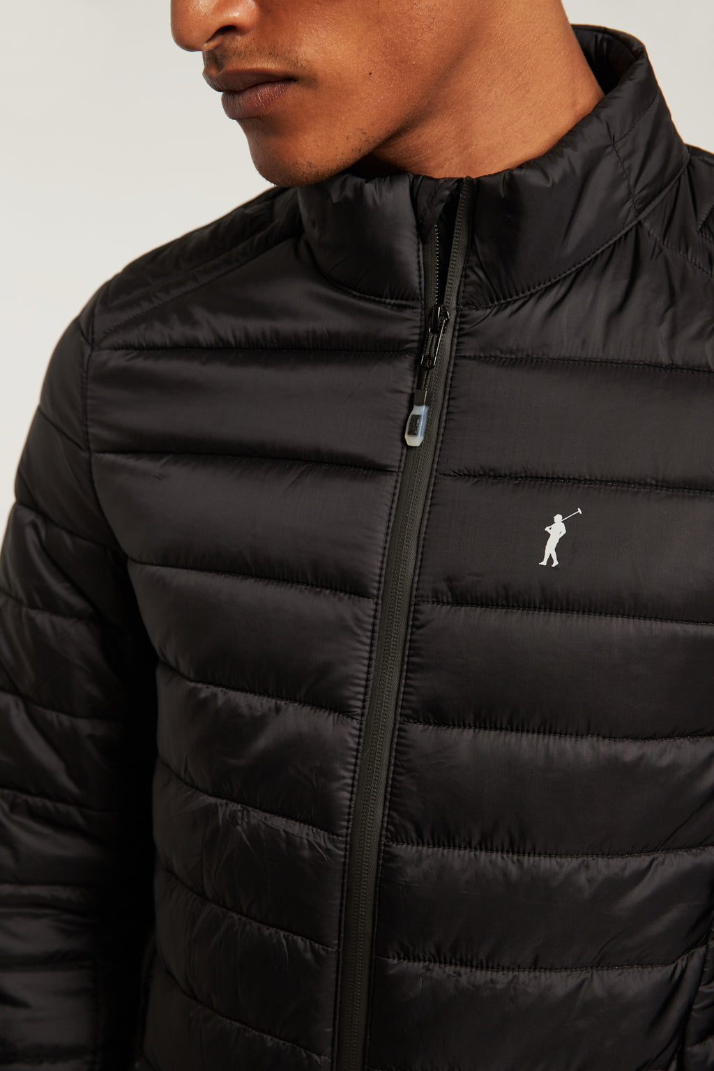 Black quilted jacket with heat-sealed zip closure