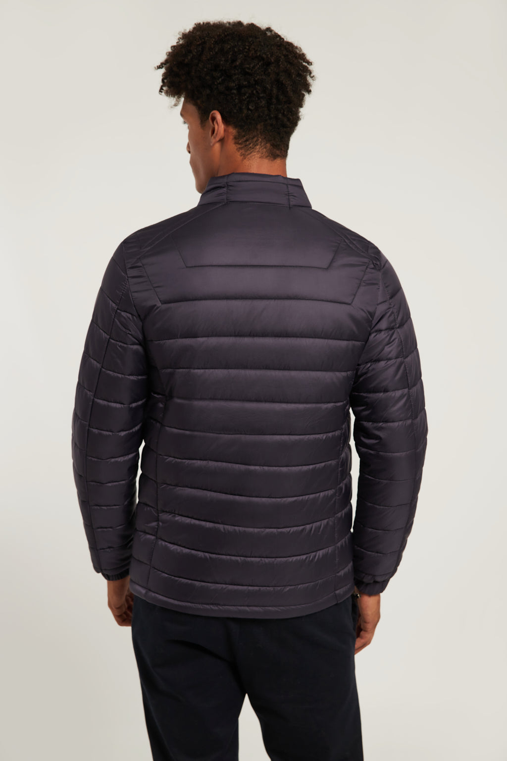 Blue quilted jacket with heat-sealed zip closure