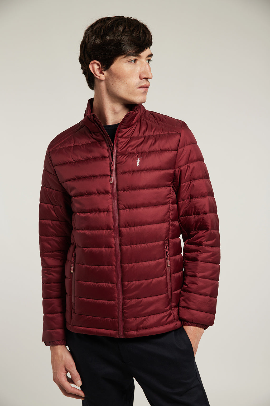 Maroon quilted jacket with heat-sealed zip closure