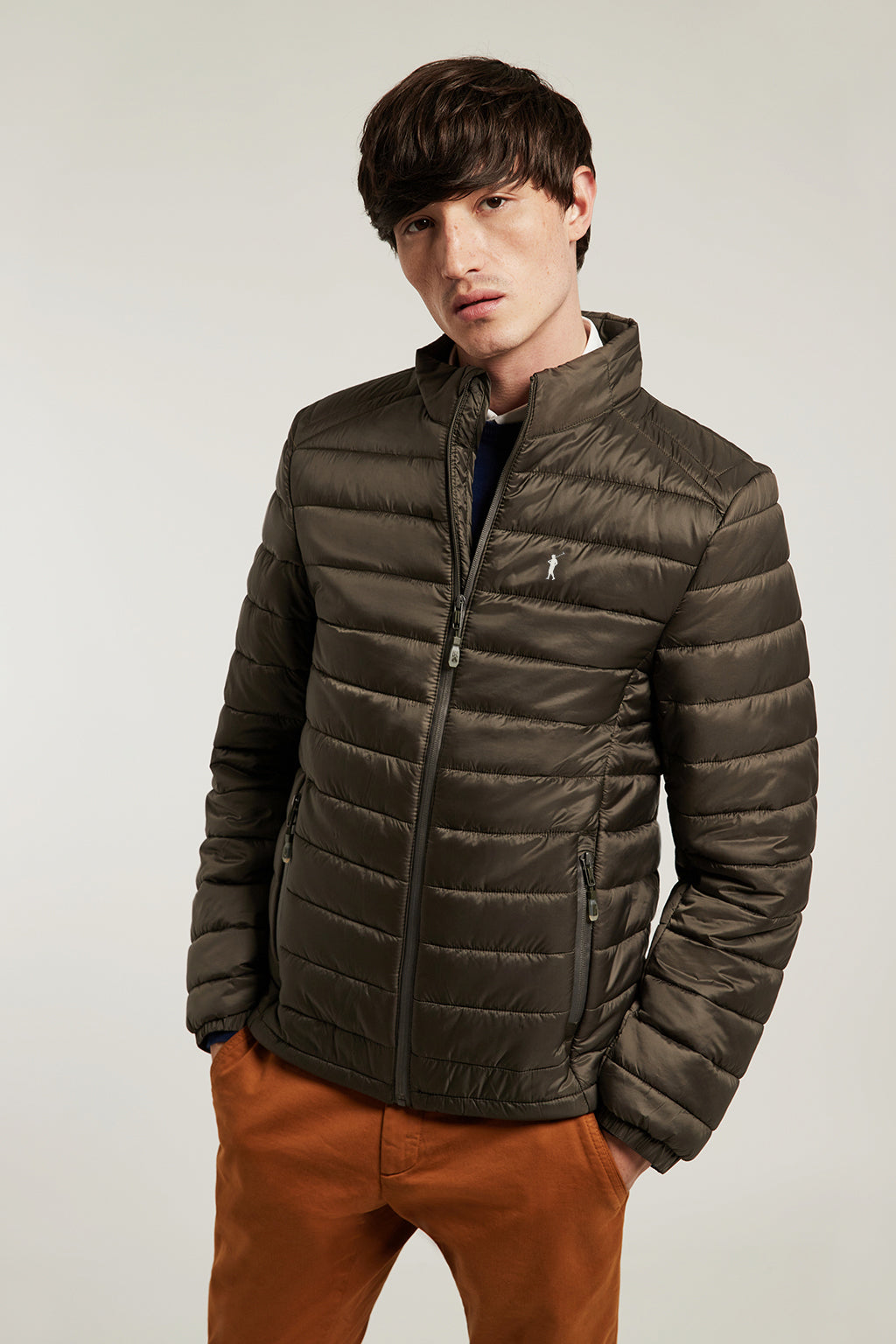 Green quilted jacket with heat-sealed zip closure