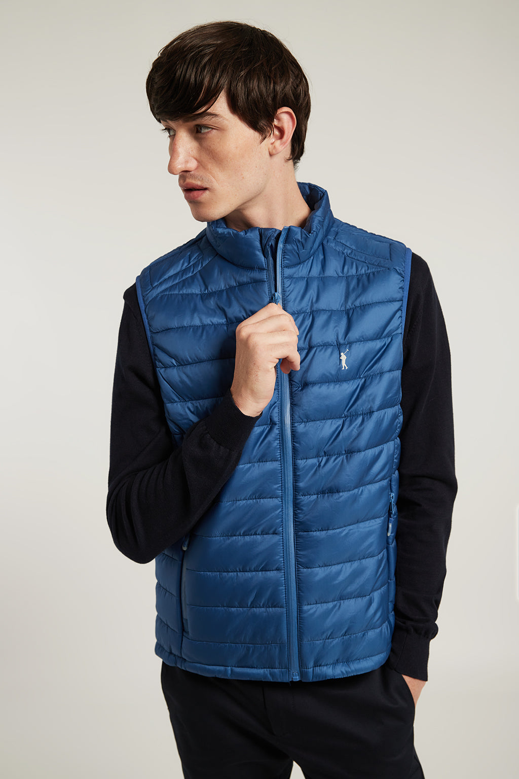 Royal blue quilted vest with heat-sealed zip closure