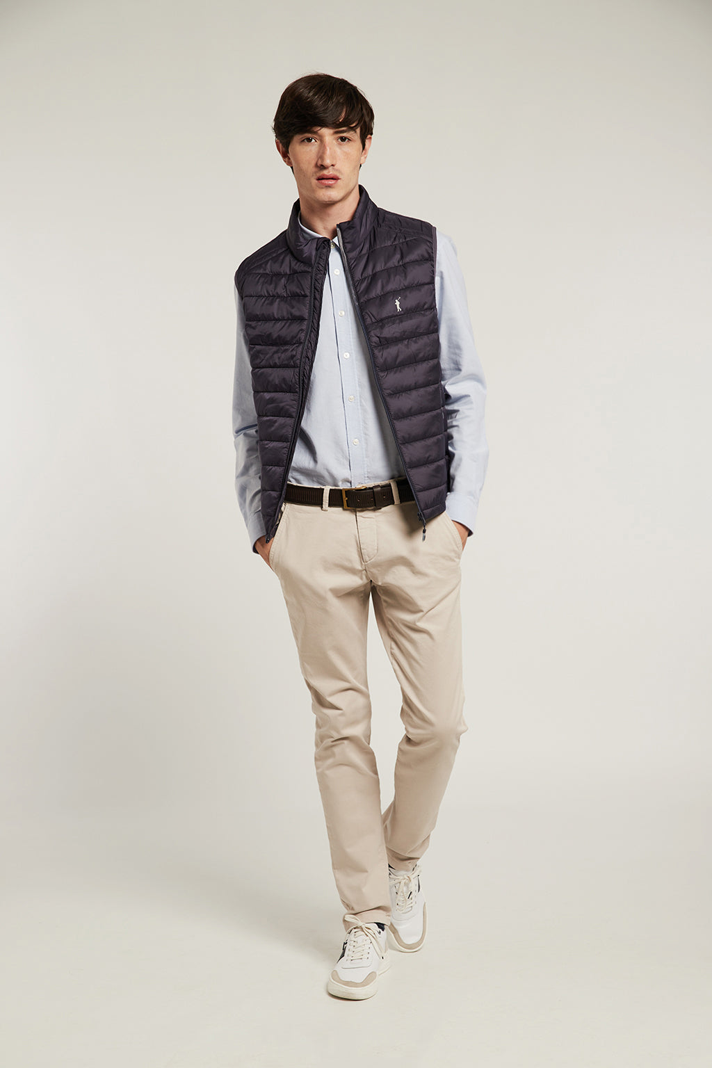 Navy blue quilted vest with heat-sealed zip closure