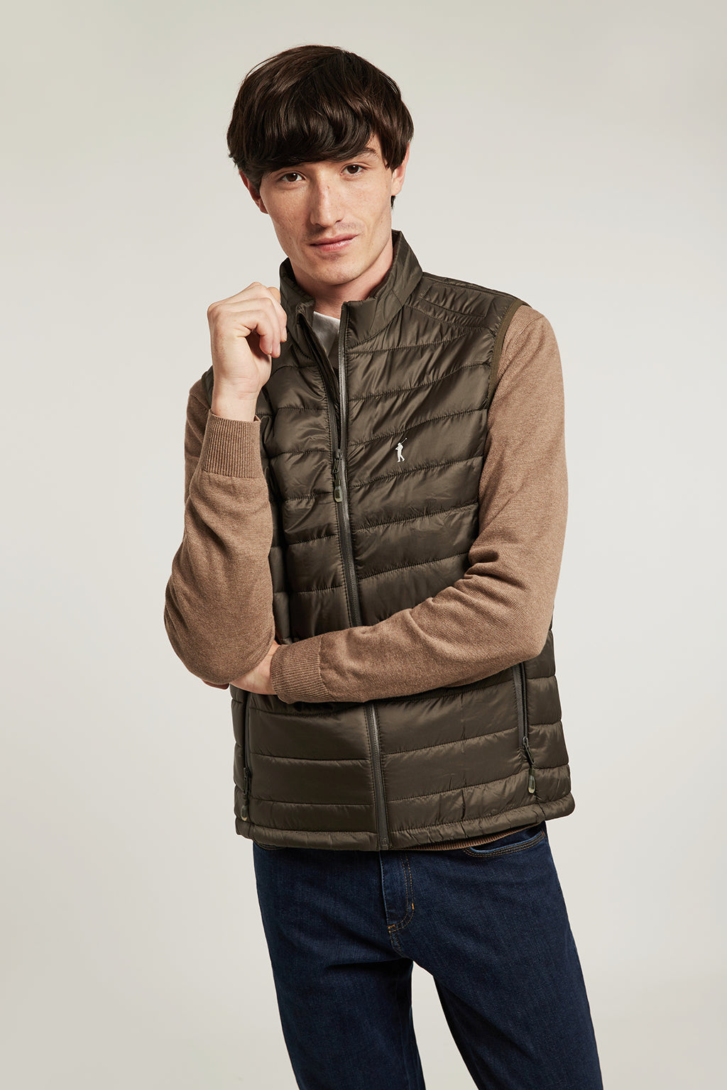 Green quilted vest with heat-sealed zip