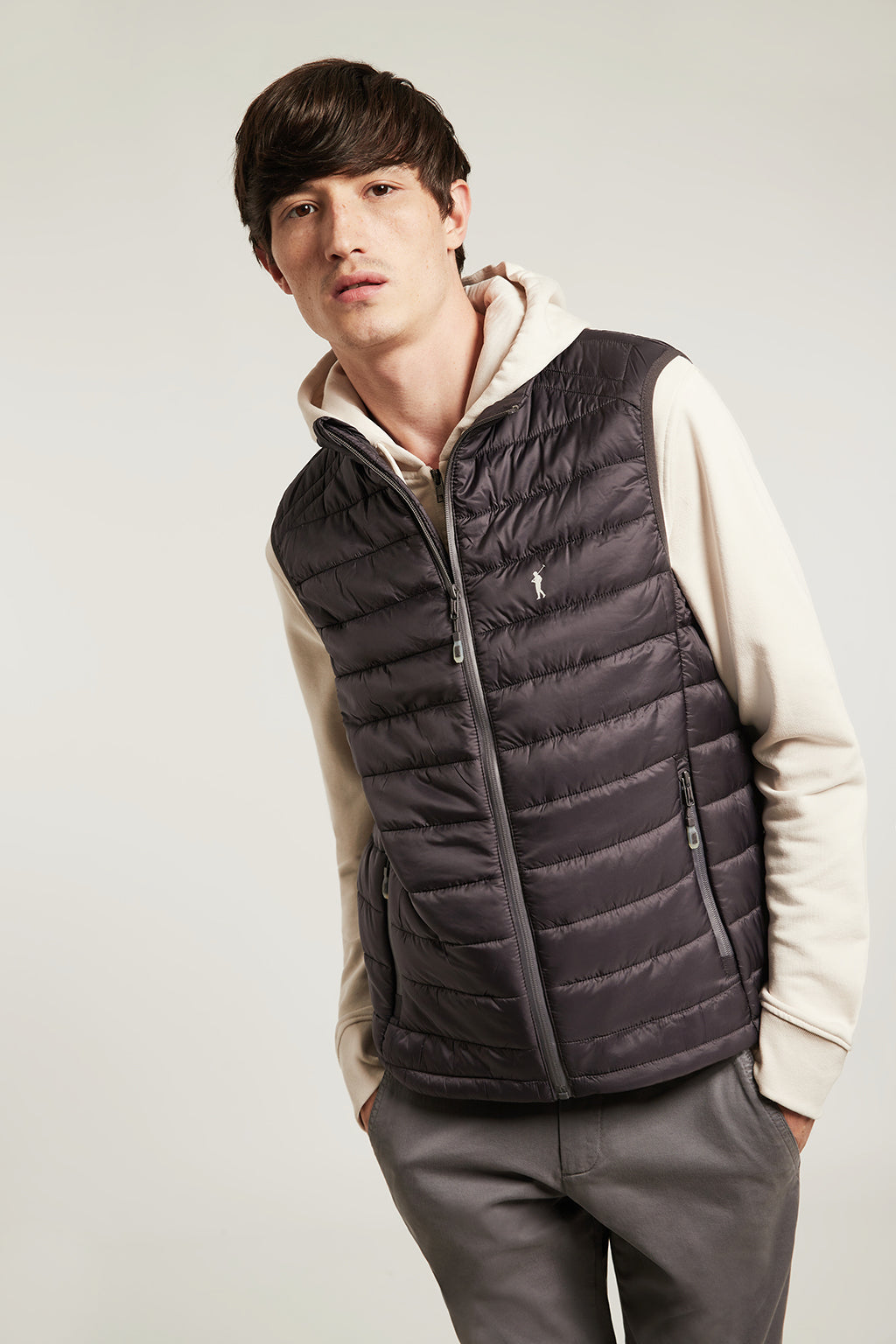 Grey quilted vest with heat-sealed zip