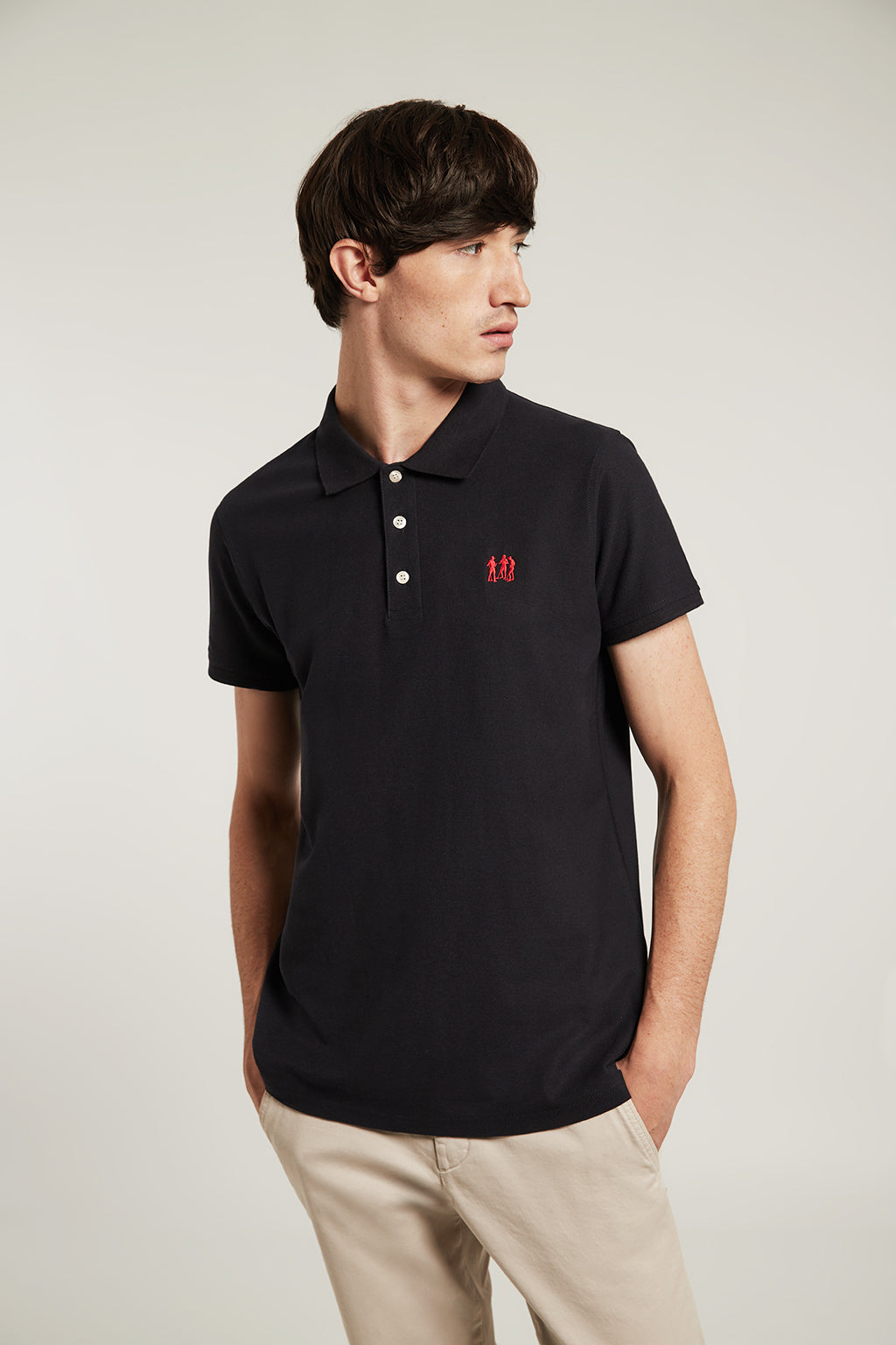 Blue polo shirt with three-button placket and embroidered logo