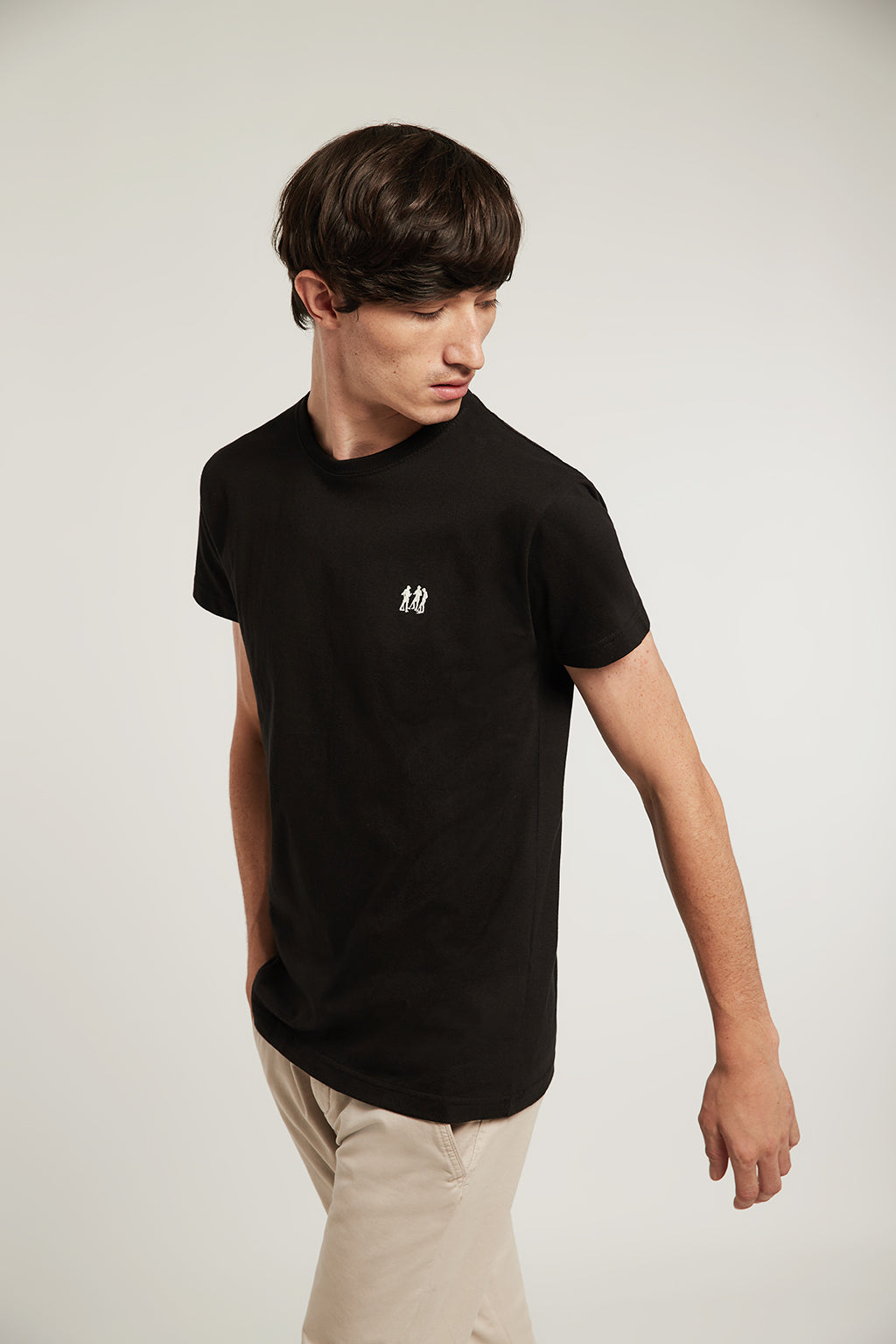 Black tee with embroidered logo and ribbed neck