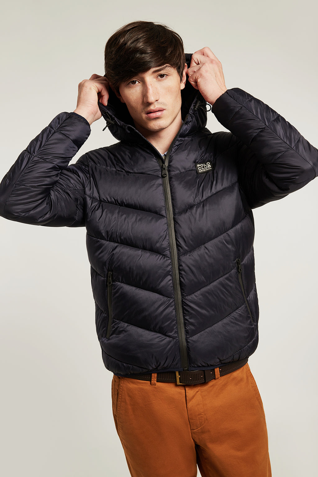 Blue quilted jacket with heat-sealed zip