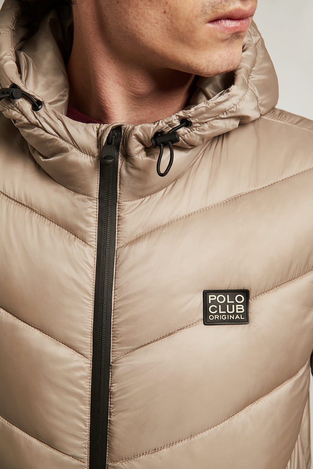 Beige quilted jacket with heat-sealed zip