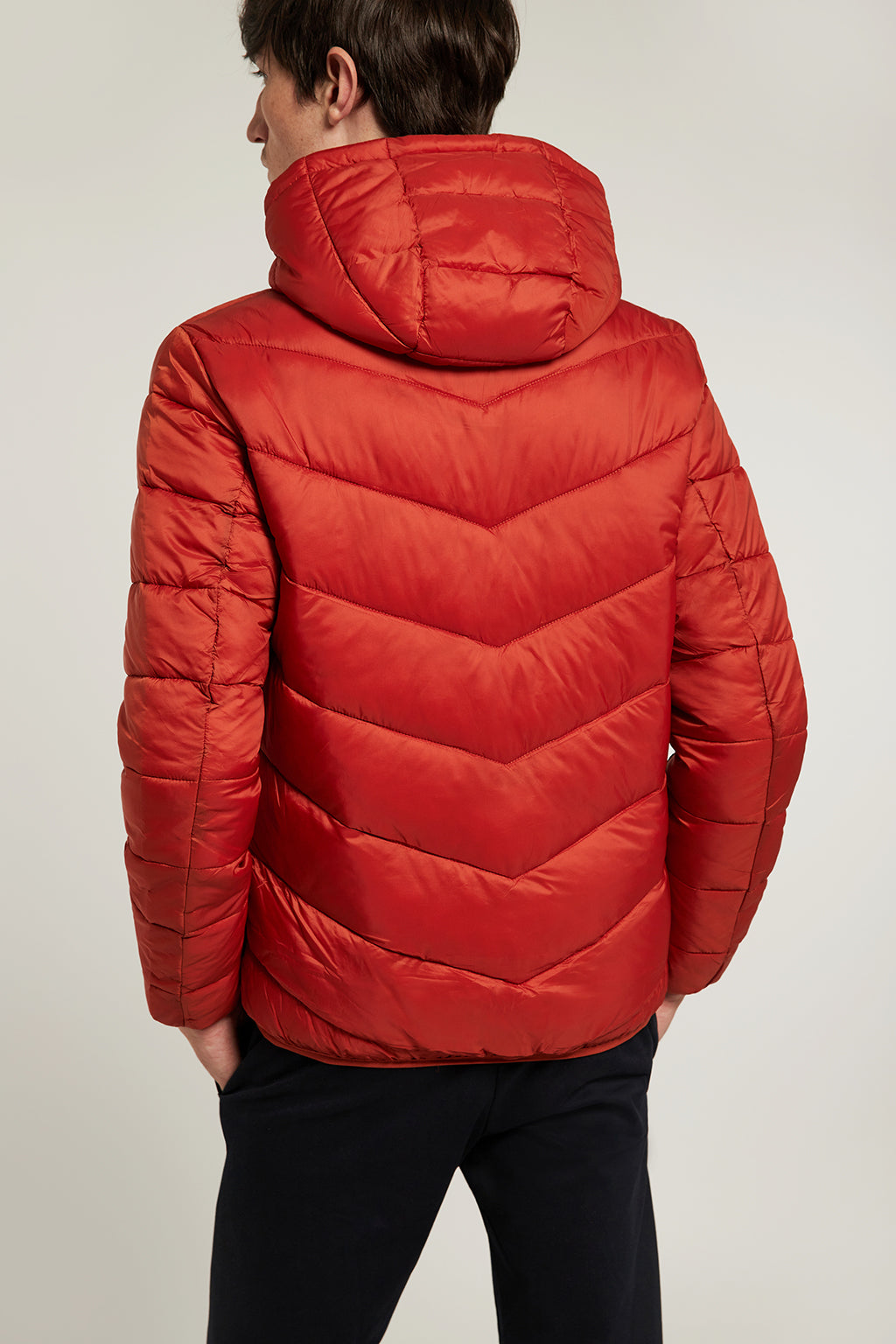 Orange quilted jacket with heat-sealed zip