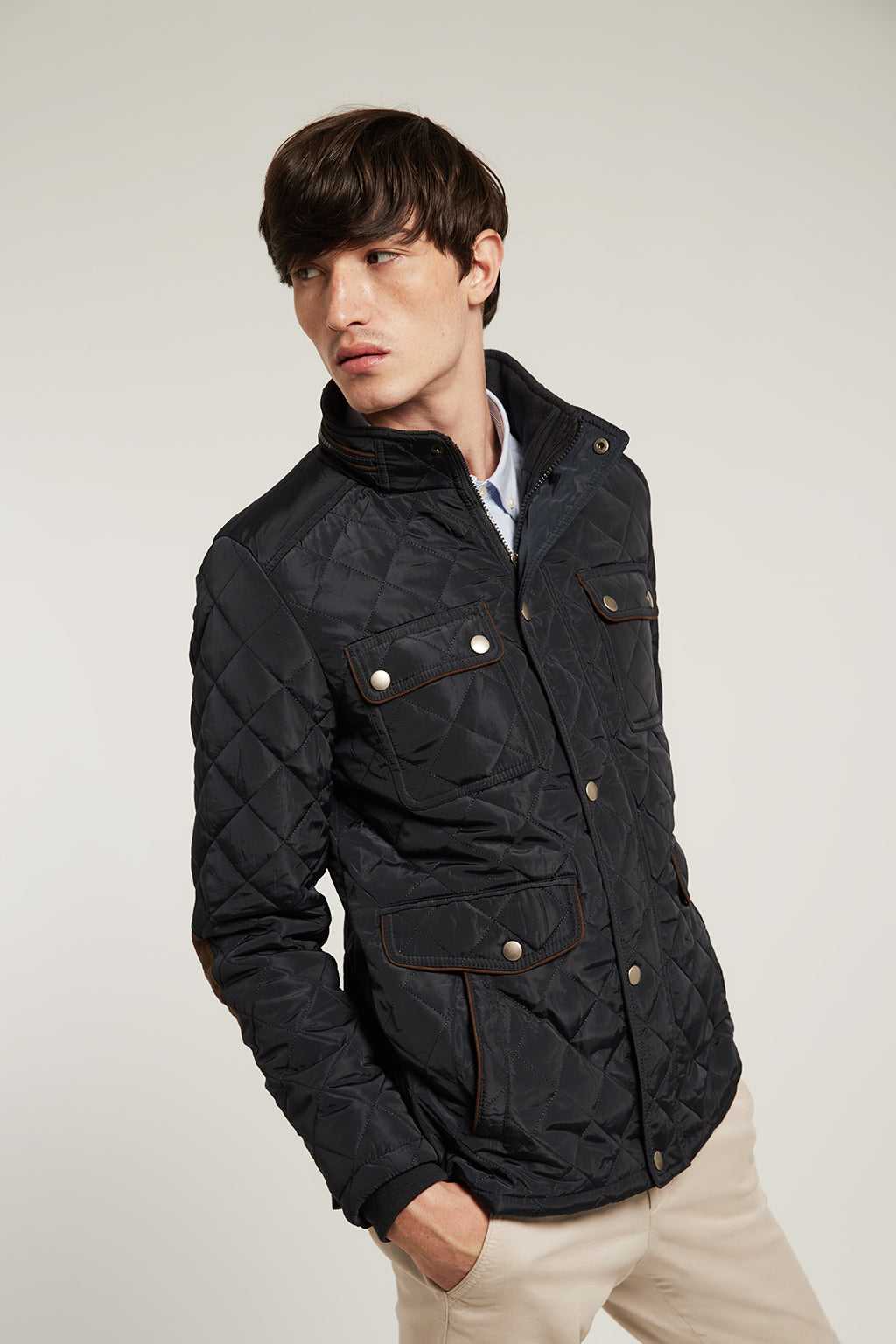 Blue quilted jacket with elbow patches