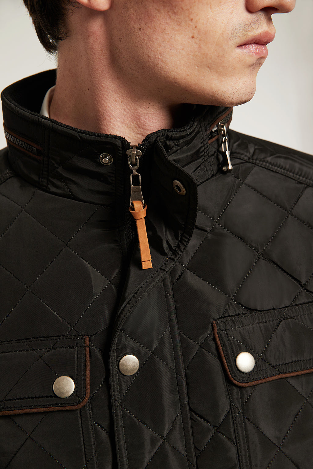 Black quilted jacket with elbow patches