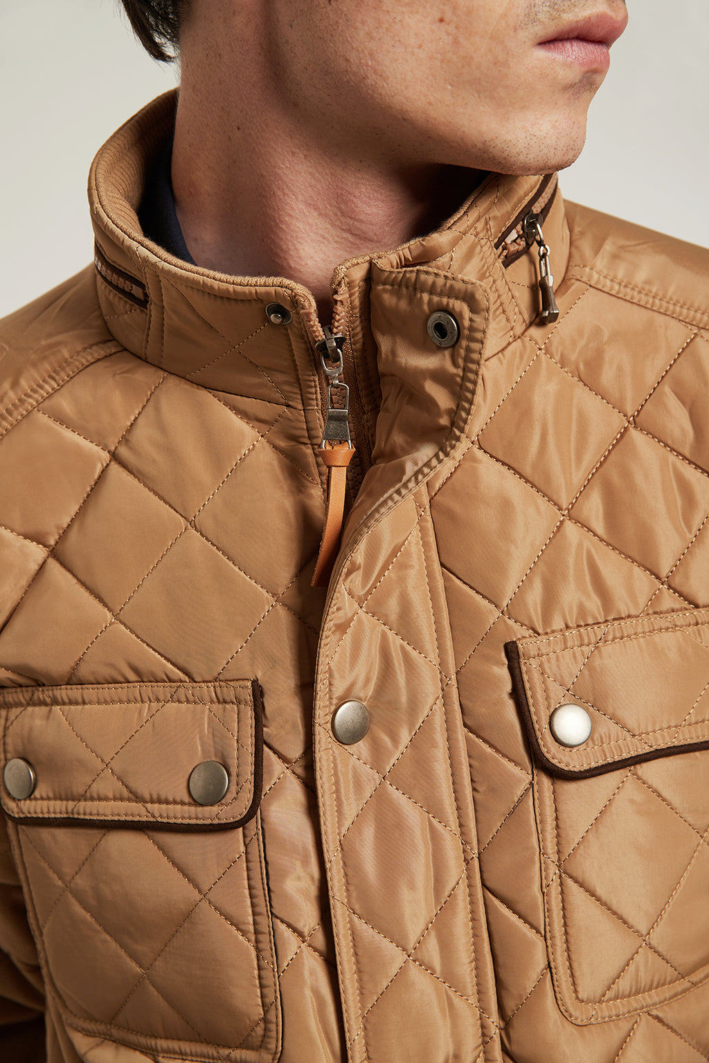 Beige quilted jacket with elbow patches