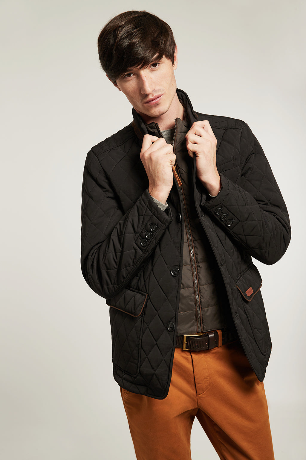 Black jacket in quilted fabric