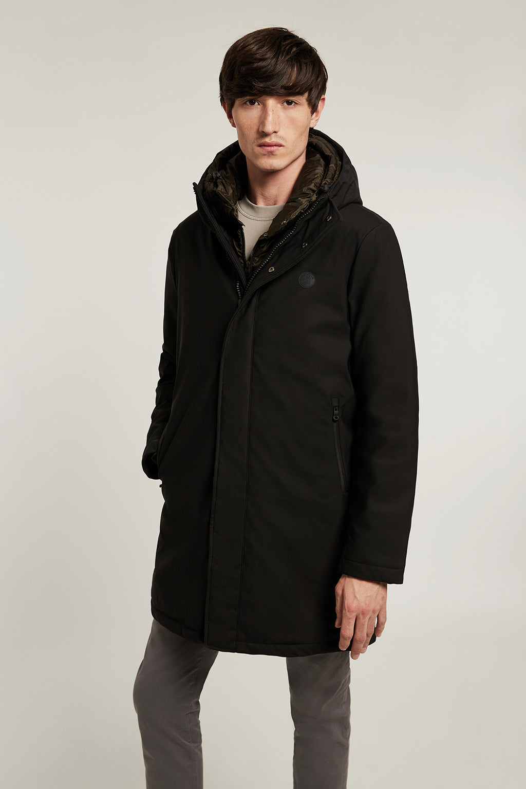 Black technical coat with quilted lining