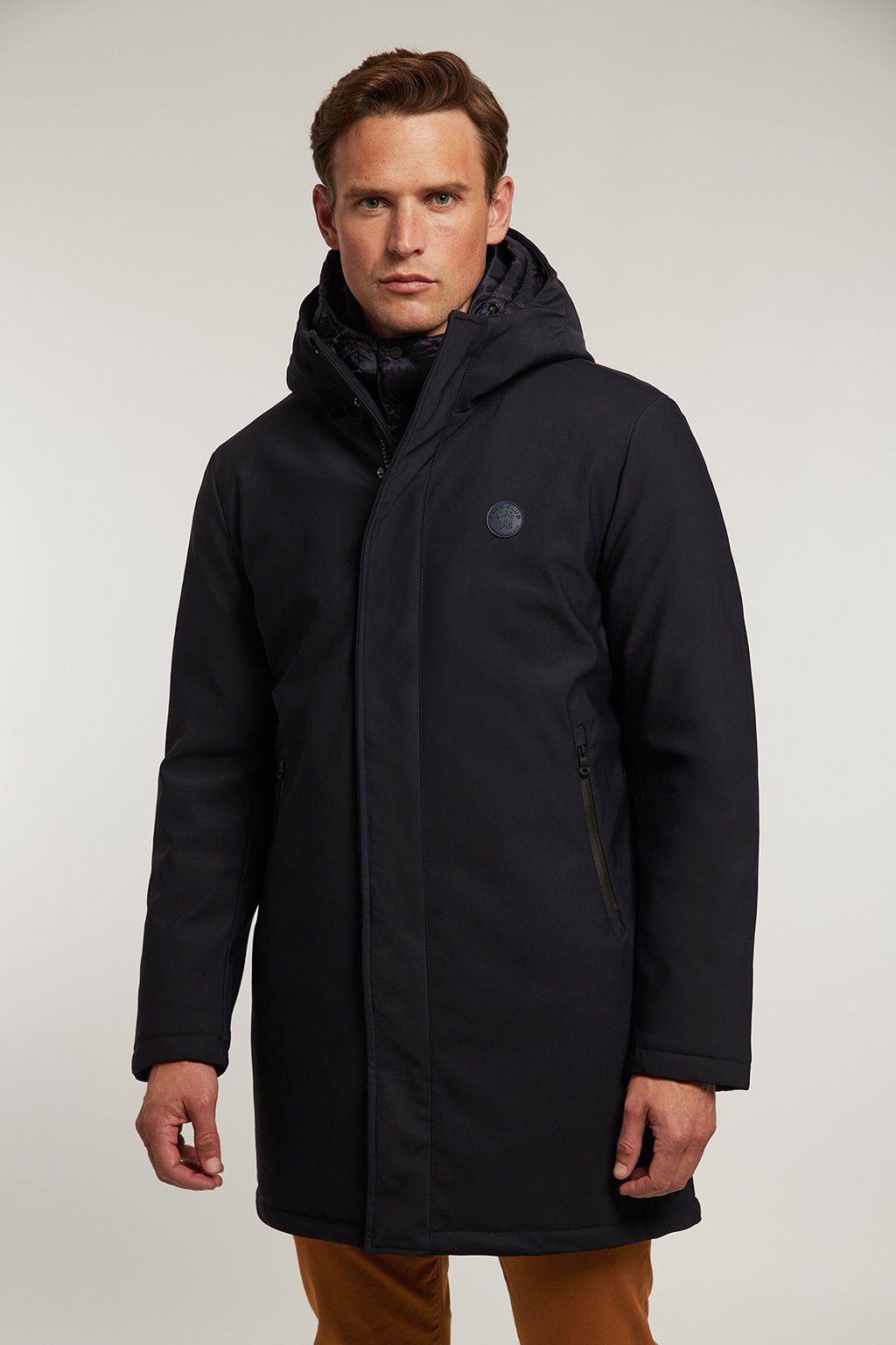 Navy blue technical coat with quilted lining