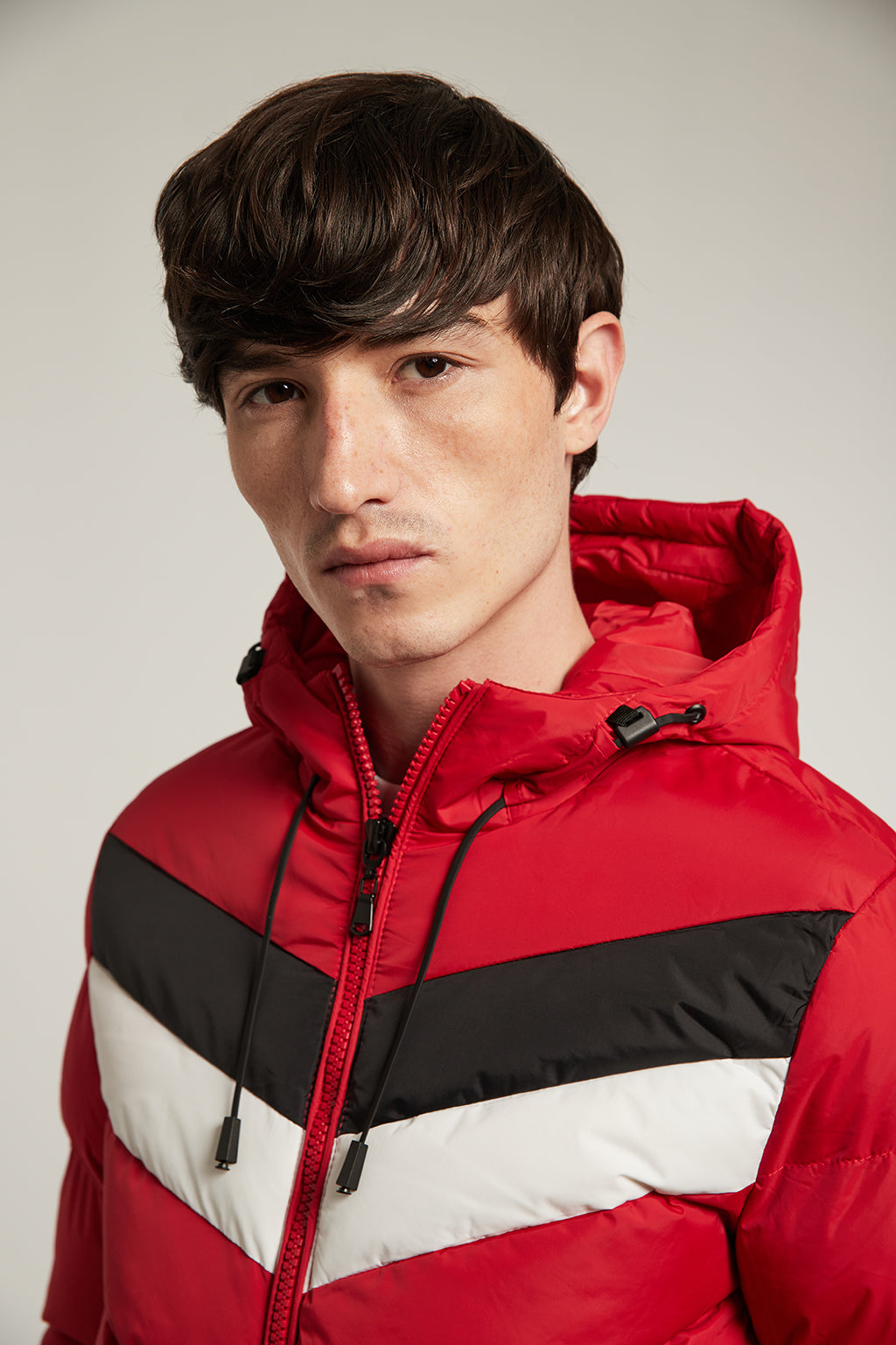 Red quilted jacket with colour stripes