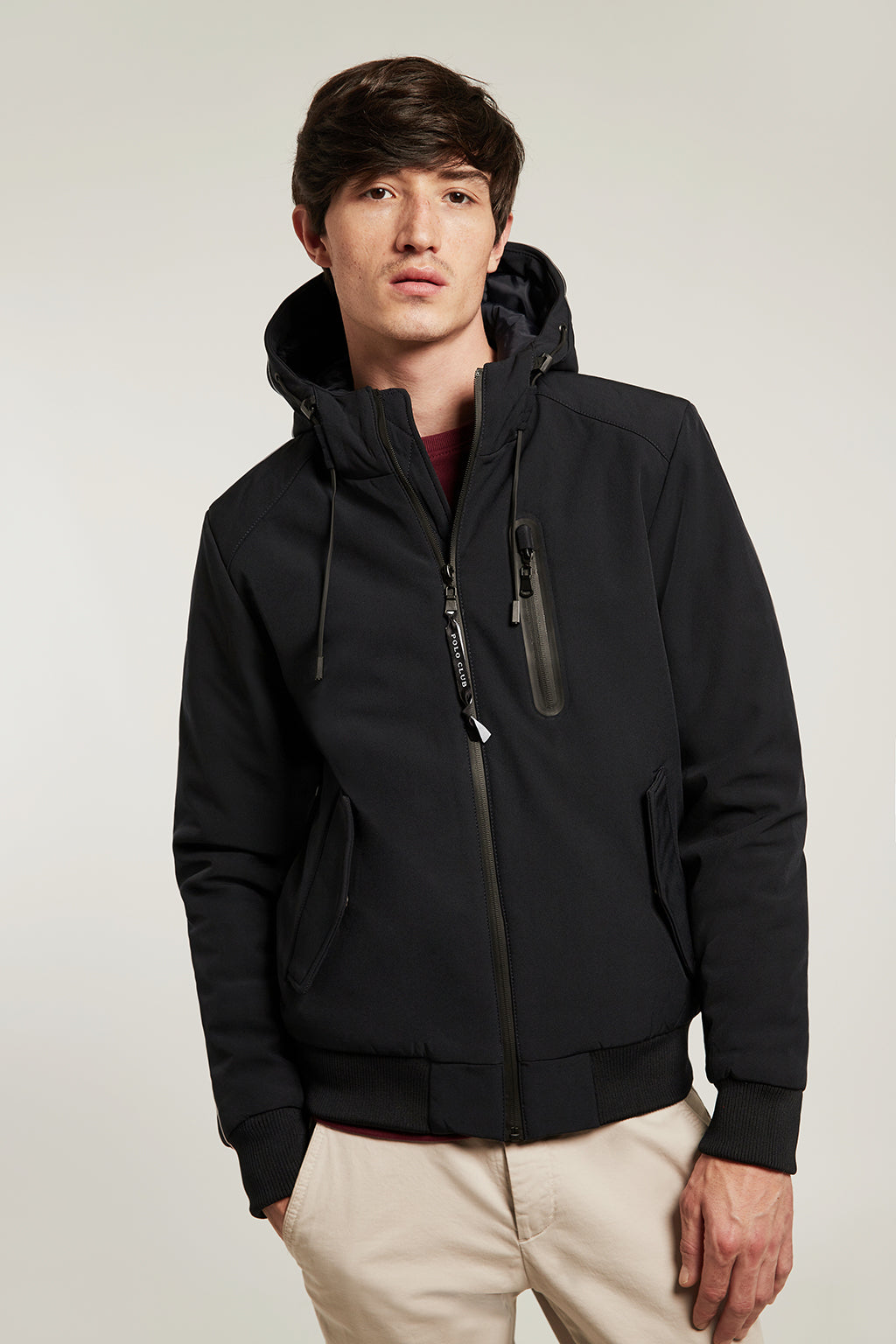 Blue jacket in technical fabric with adjustable hood