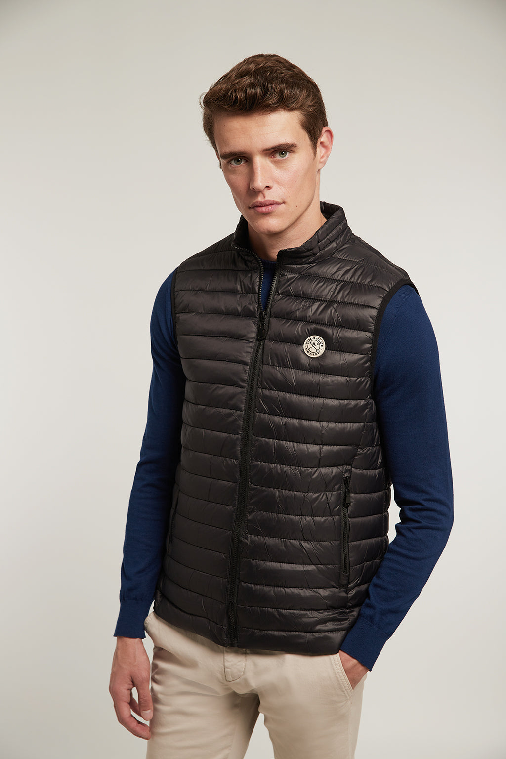 Black quilted vest with slightly high neck