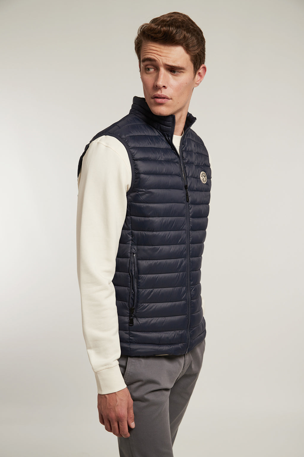 Navy blue quilted vest with slightly high neck