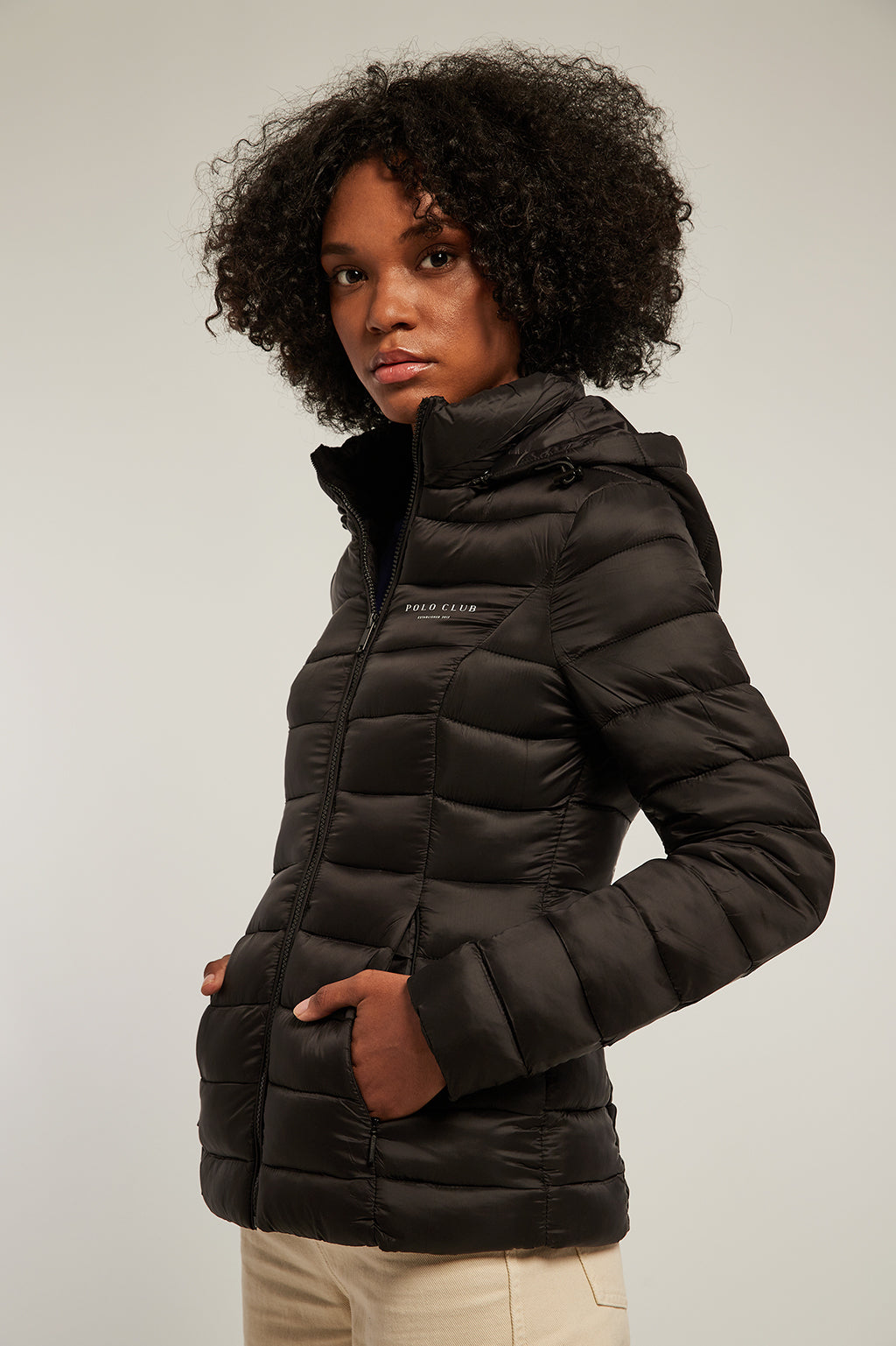 Black quilted and fitted jacket with hood