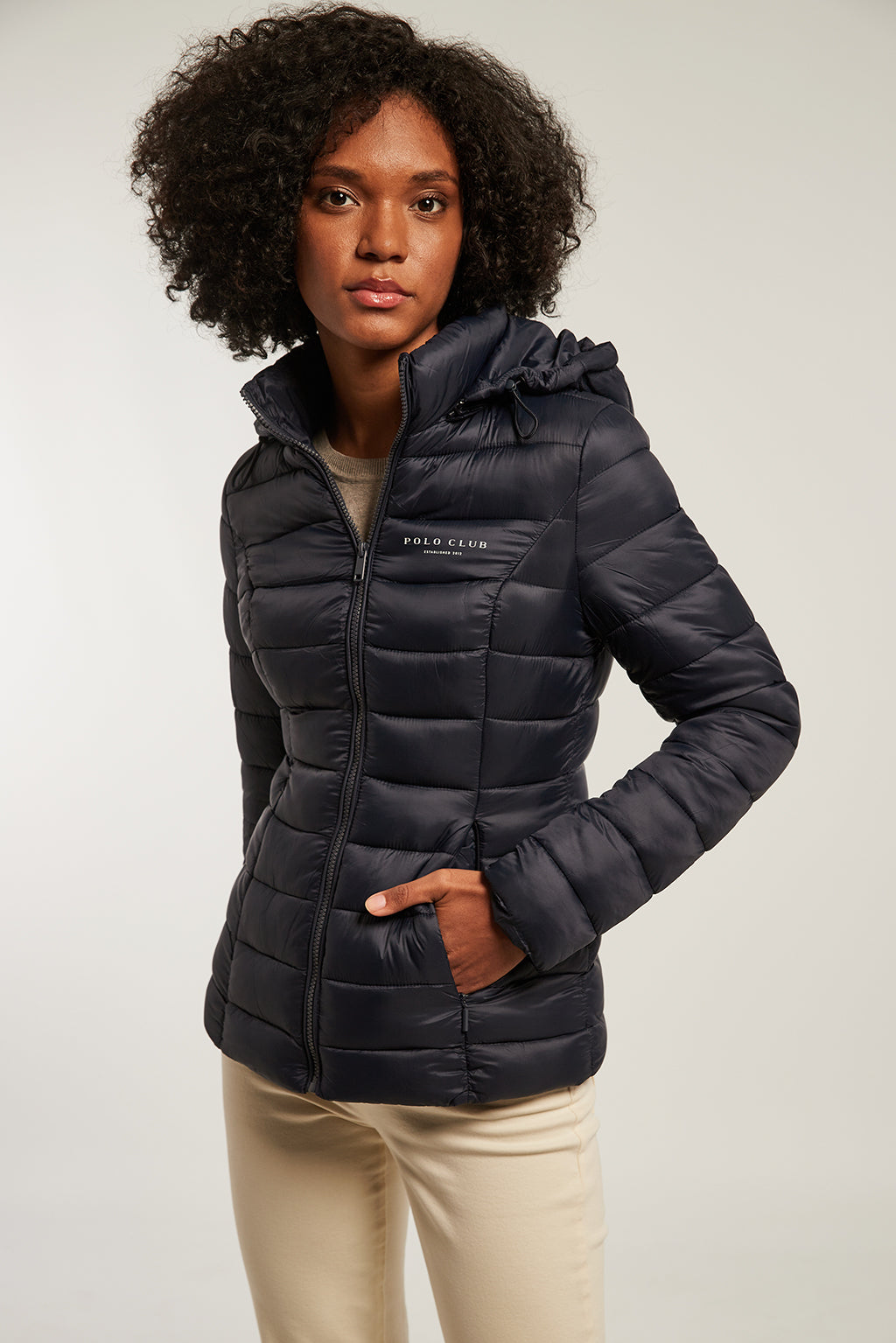 Navy blue quilted and fitted jacket with hood
