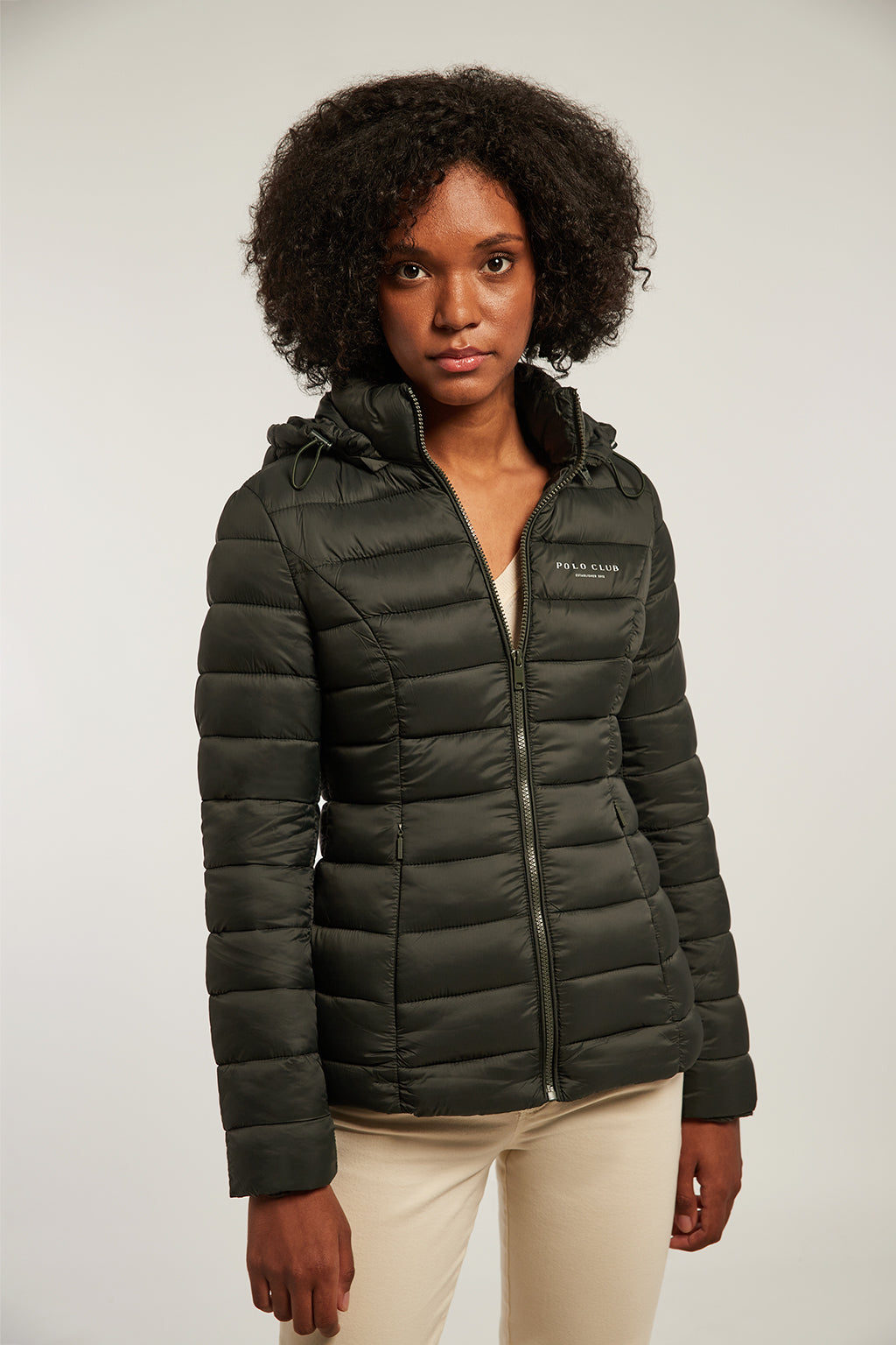 Green quilted and fitted jacket with hood
