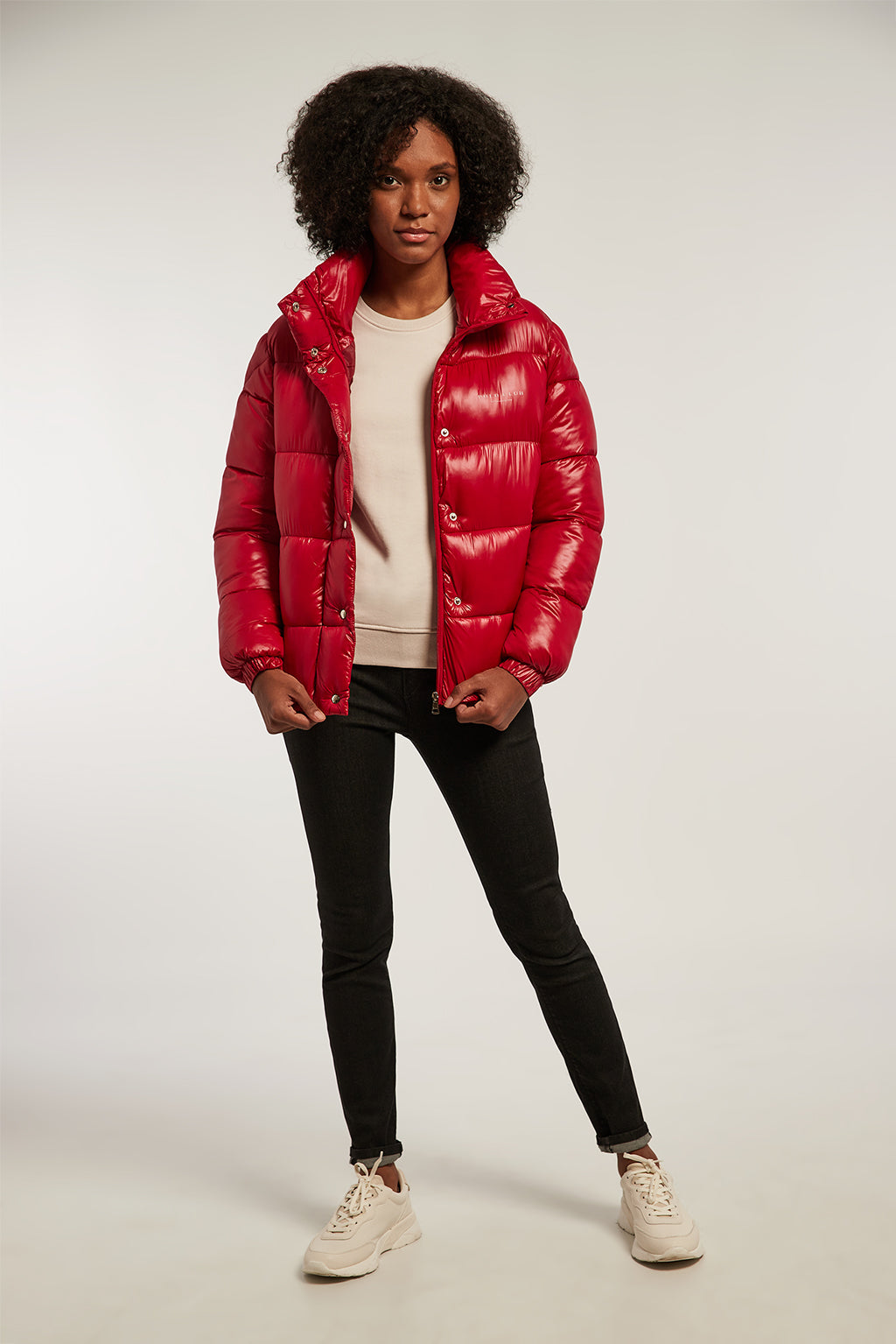 Red quilted jacket with high neck