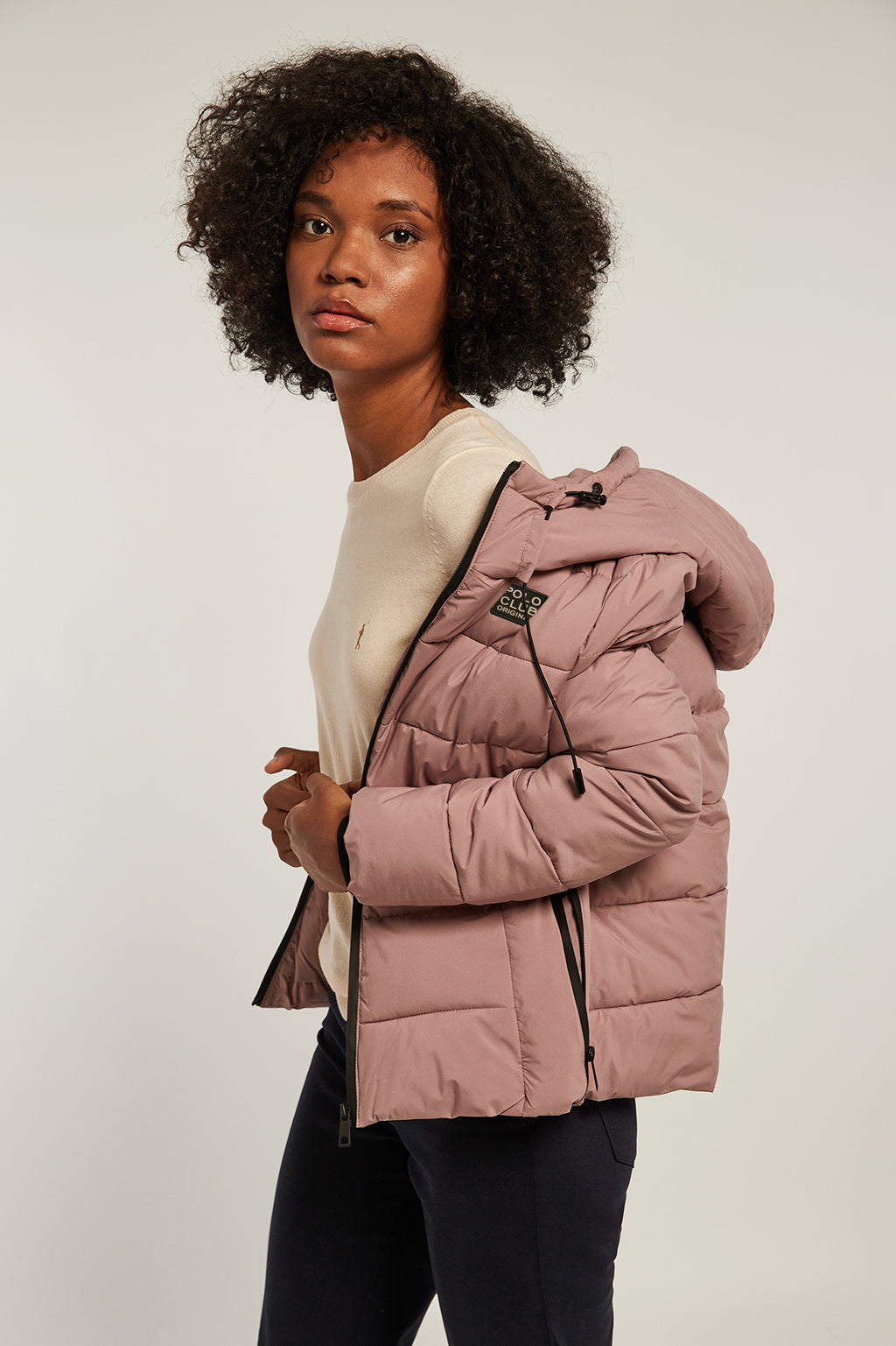 Pale blush pink hooded quilted jacket with double cuff