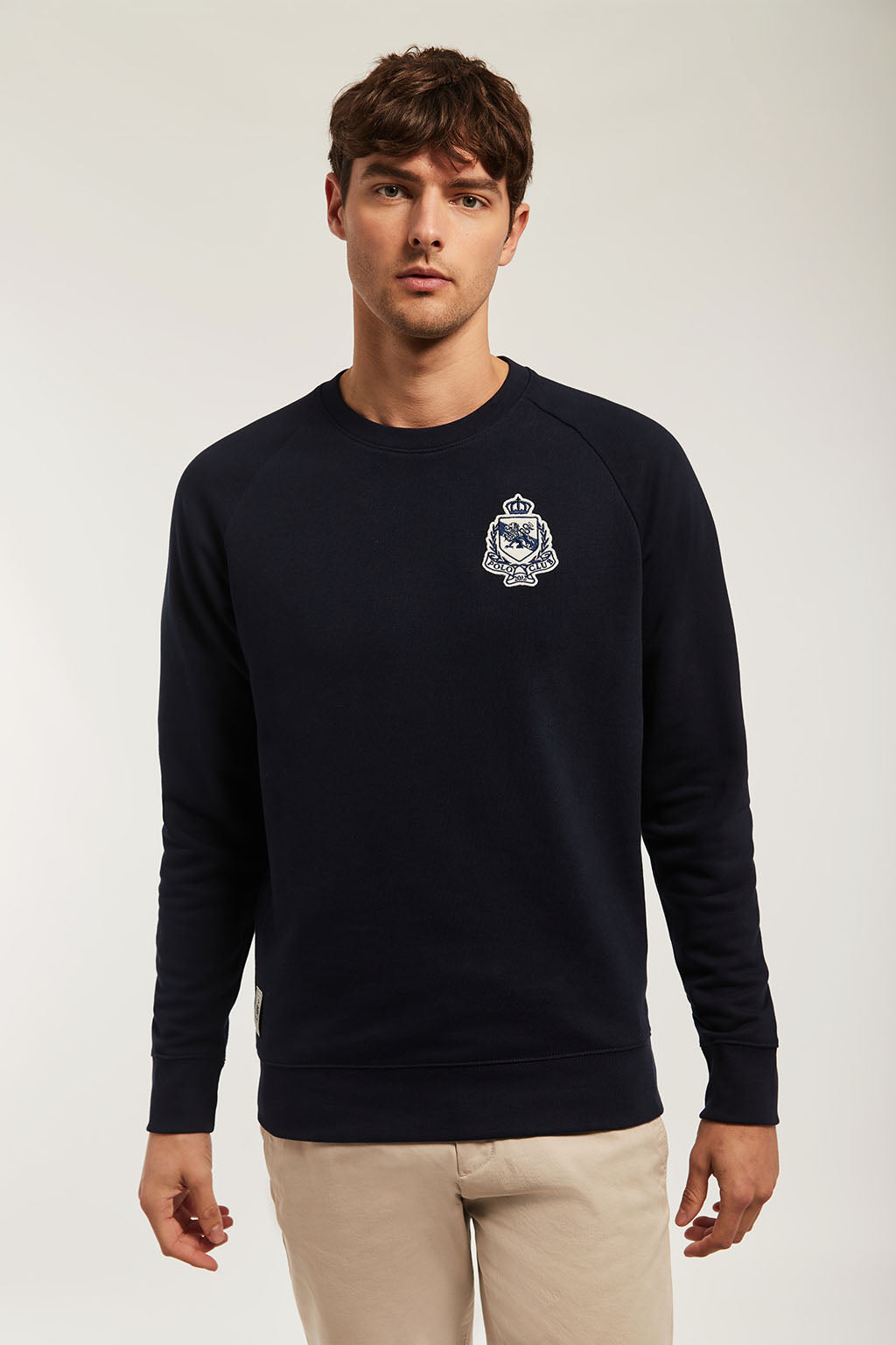 Navy blue organic sweatshirt with contrast embroidered patch
