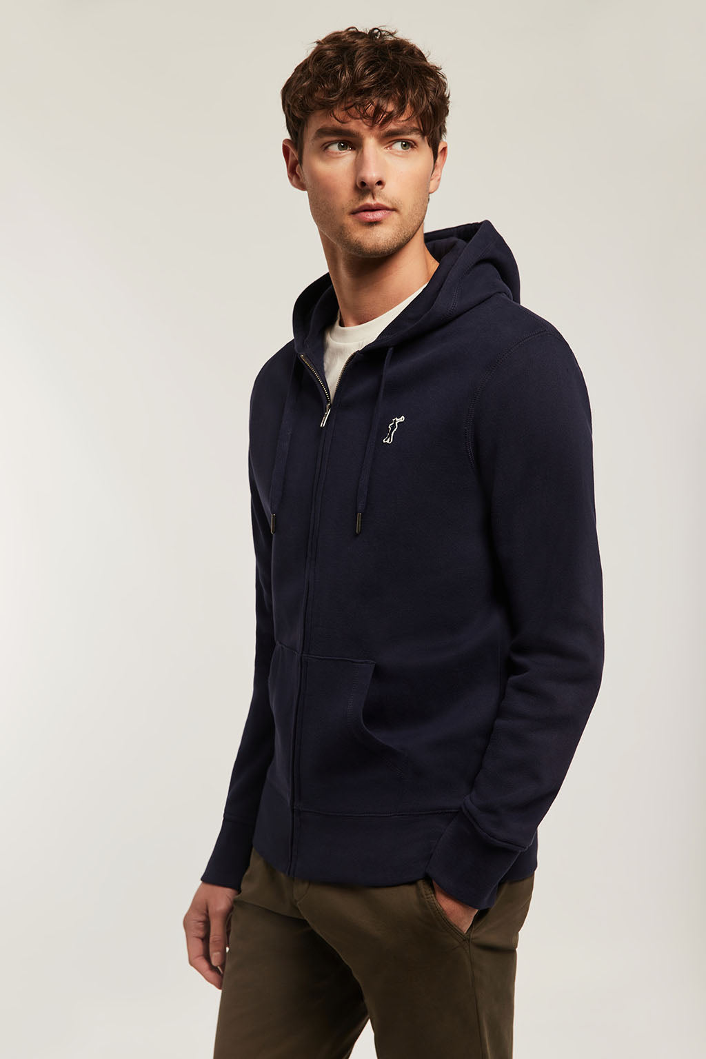 Navy-blue zipped hoodie with contrast patch