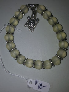 Light Beige-Green Beaded Bracelet With Sterling Silver Plated Sea Turtle Charm