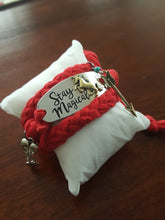"Load image into Gallery viewer, Red Hand Braided Wrap Bracelet With ""Stay Magical"" Horse Buckle"