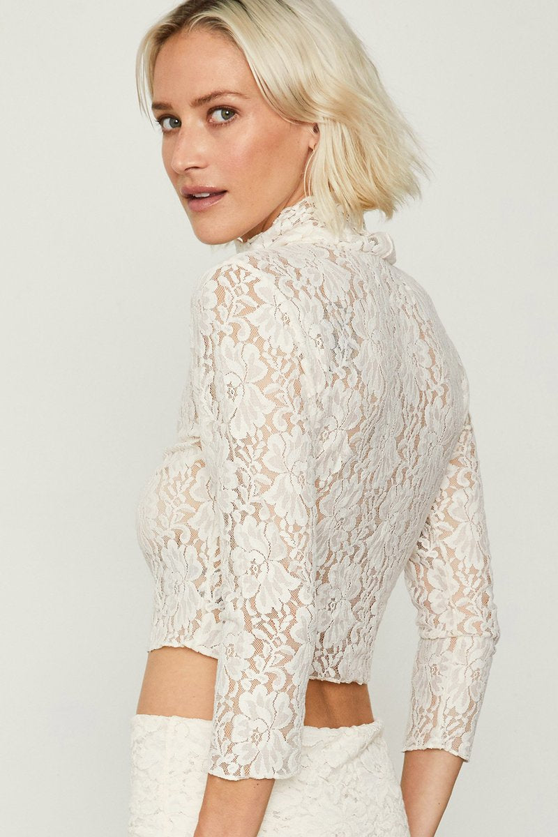 We are HAH Crop-2-a-T Lace Cropped Turtleneck