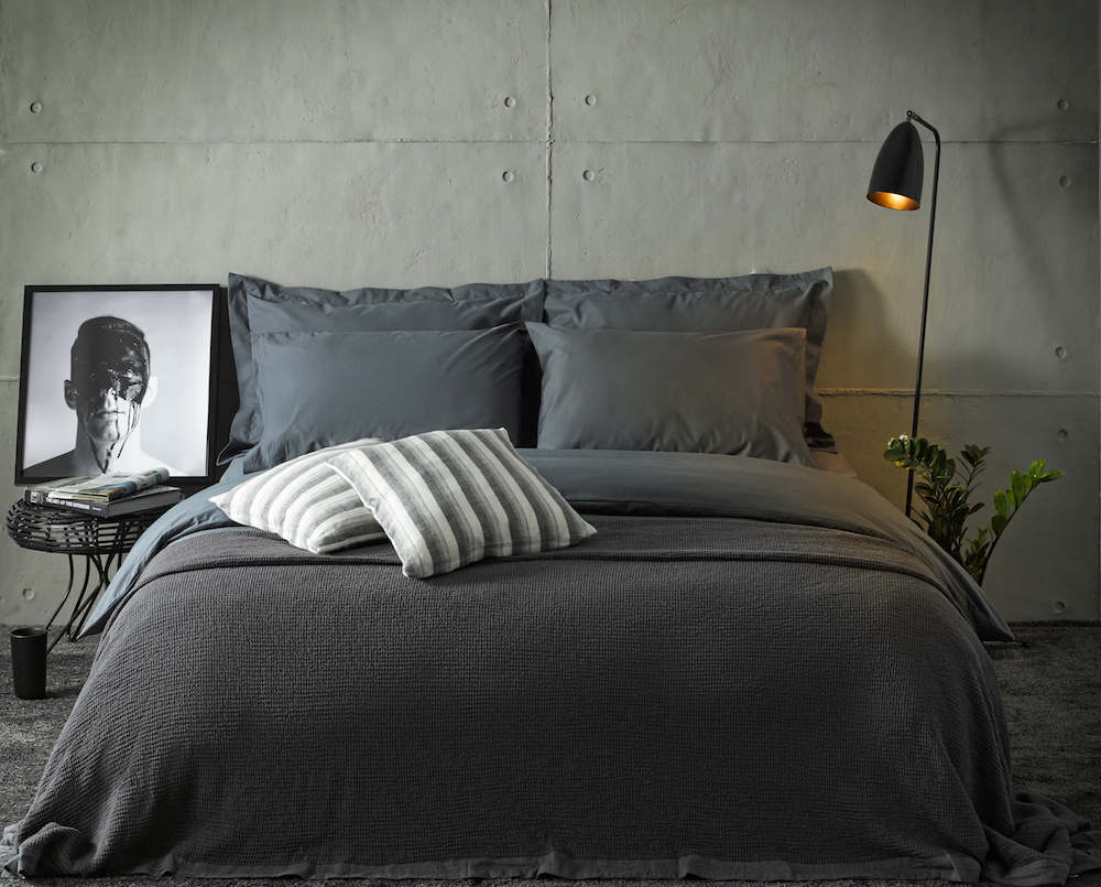 dark grey bedding set with bedspread and extra pillowcases