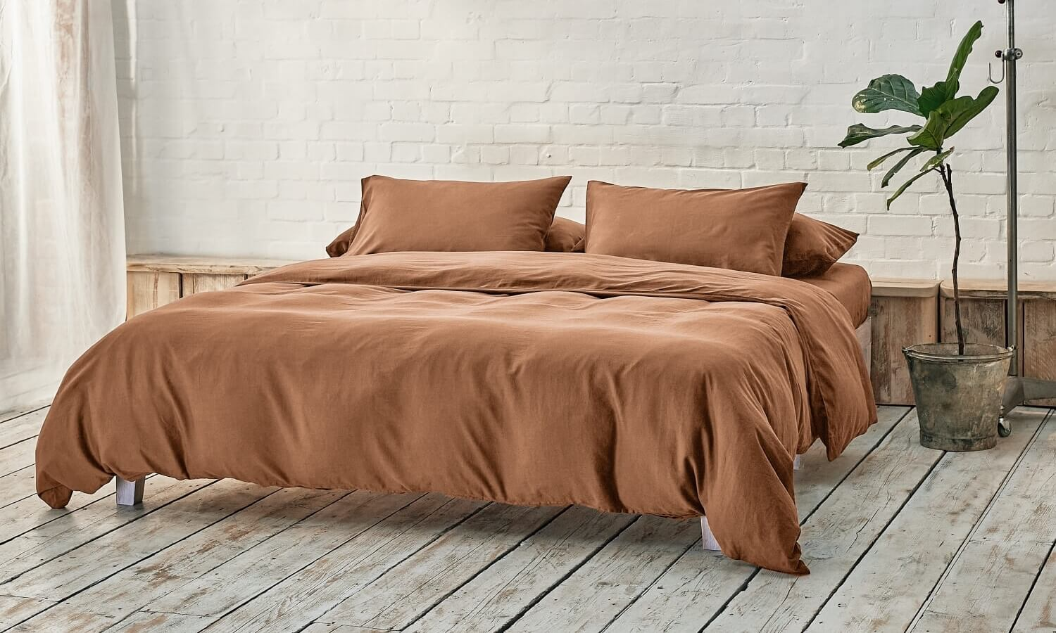 caramel brown bedding on bed in a modern room