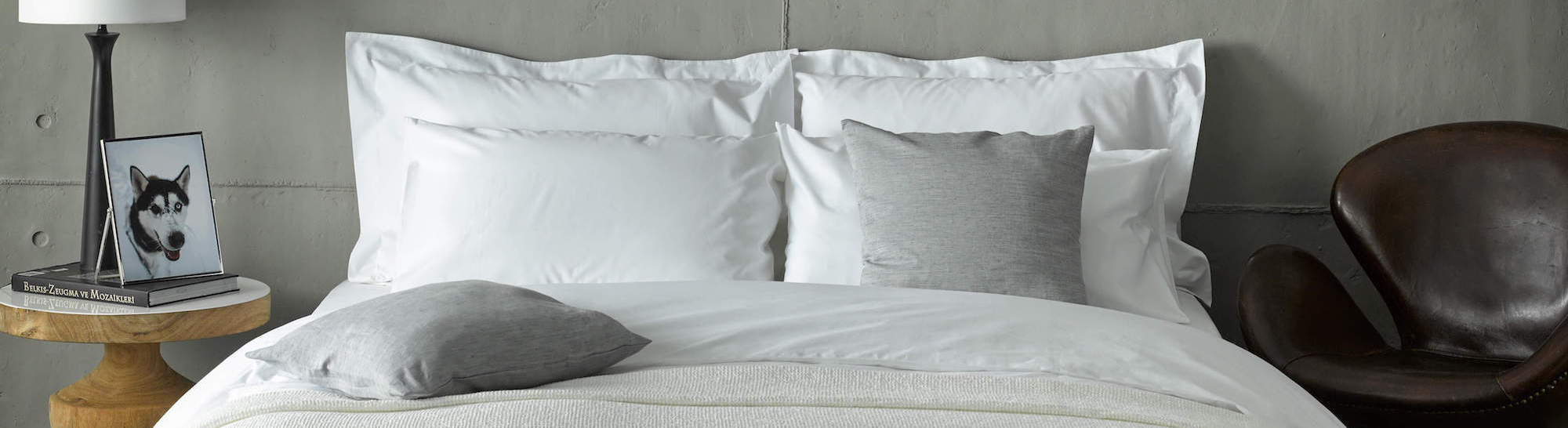 cotton white bedding bundle on bed in a loft apartment
