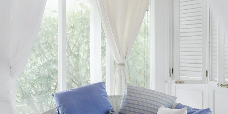 plain white curtains with window view