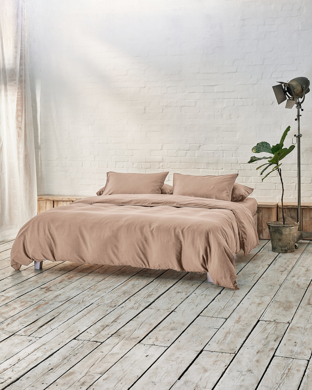 beige bedding set including a fitted sheet, duvet cover and pillowcases