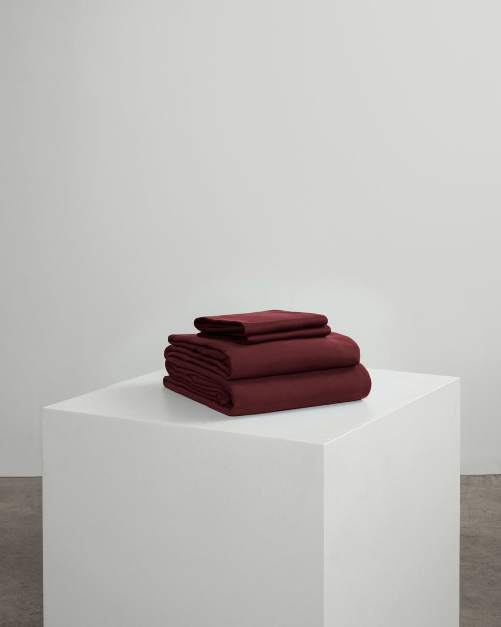 Burgundy full bedding set including a fitted sheet, duvet cover and pillowcases