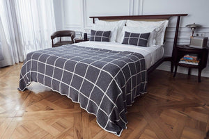 grey checkered scatter cushions on bed