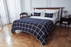 navy checkered luxury bedding set on bed