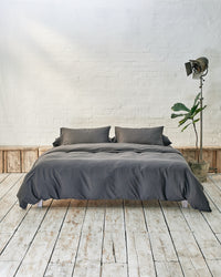 dark grey duvet cover set on a platform bed