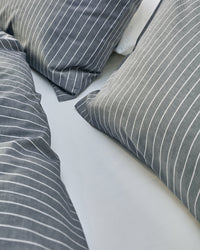 navy and white striped cotton bedding texture
