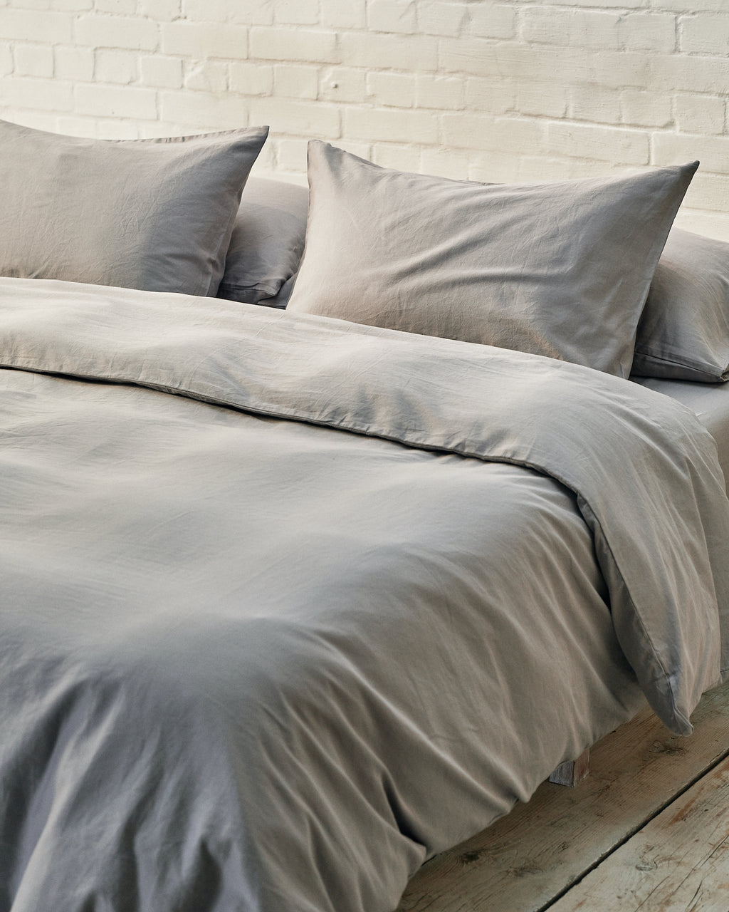silver grey duvet cover set on a platform bed